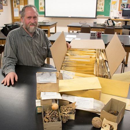 High Plains Herbarium director and Chadron State College faculty member Steve Rolfsmeier poses with a donated collection of several hundred specimens of lichens, mushrooms, mosses and liverworts collected in the Pacific Northwest in 1961 by the  late Charles Sulzbach, a native of Alliance. (Tena L. Cook/Chadron State College)