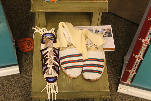 """""""Parading Through History: The Apsaalooke Nation"""" exhibit in the Sandoz Center. The exhibit takes visitors on a chronological journey through the history and culture of the Crow tribe. (Alex Coon/ Chadron State College)"""