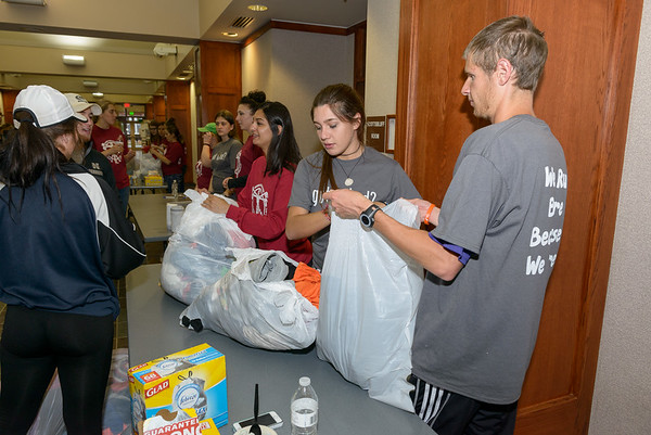 Students sort through clothing donations prior to the Nearly Naked Mile. (Photo by Daniel Binkard/Chadron State College)